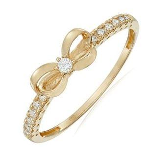 anillo de oro para niña con lazo y brillantes