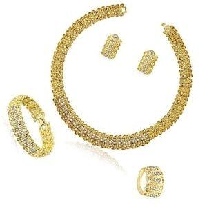 conjunto de anillo, collar, pendientes y pulsera de oro amarillo