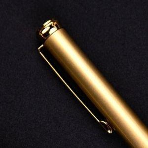 pinza del boligrafo de oro