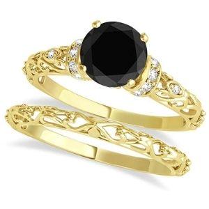 conjunto de anillos nupciales, de oro amarillo de 18 k con diamante negro