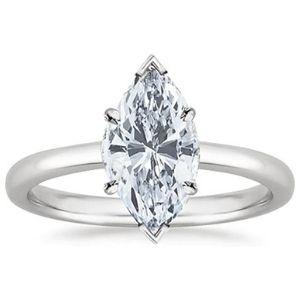 anillo de compromiso tipo marquesa, de oro blanco de 18k con diamante