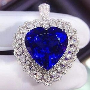 colgante para mujer, de oro blanco de 18 k con tanzanita en forma de corazon y diamantes