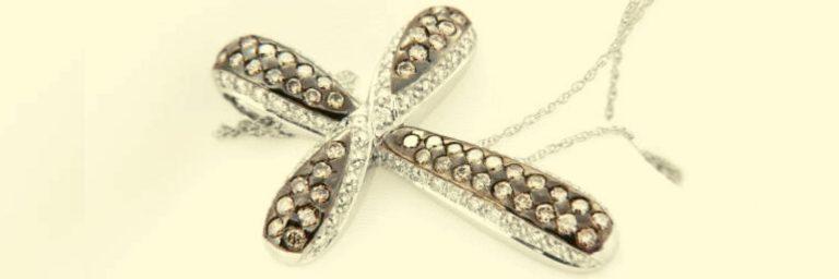 como elegir las cruces de oro con diamantes